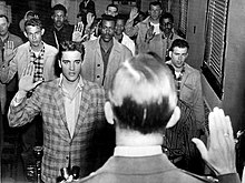220px-Elvis_sworn_into_army_1958.jpg